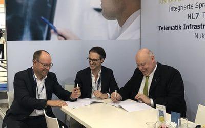 medavis and Radiology Holding GmbH seal strategic partnership at the RöKo